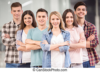 Group interaction - Successful team Group of cheerful young...