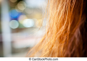 Long gold hair on bokeh background Macro shot