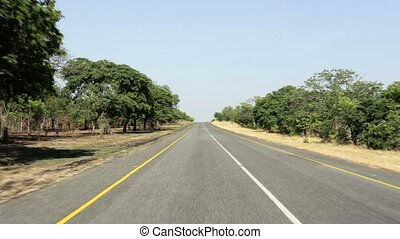 Driving on Endless road in Namibia, Caprivi Game Park, with...