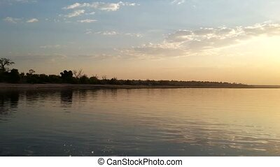 African sunset on Chobe river view from boat, Chobe National...