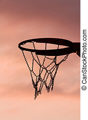 Basketball hoop in sunset