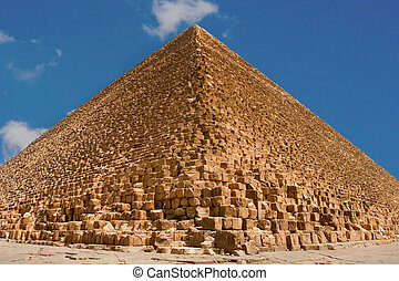 Great pyramids of Giza with blue sky on background