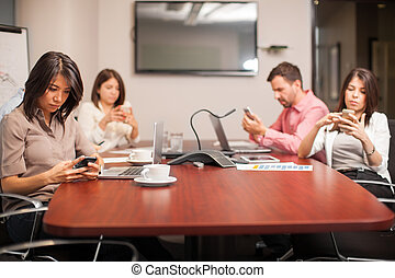 Distracted by technology - Group of people sitting in a...