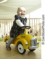 Smiling Baby Riding Toy Car - Smiling baby girl riding toy...