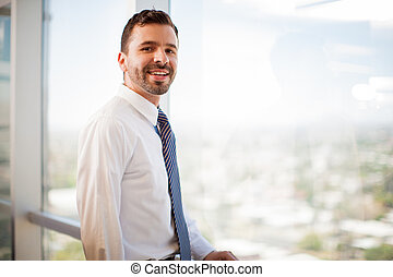 Happy Hispanic businessman