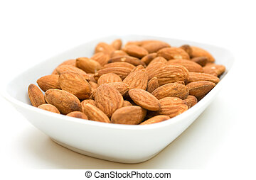 Almonds in bowl over white background