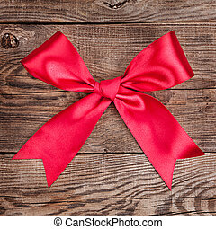 red bow on the old board