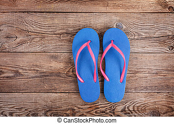 beach slippers on the old board