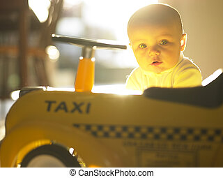 Baby with Toy Car - Baby playing with toy taxicab car...