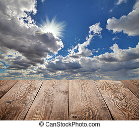 Atmosphere background. Sky and clouds with wooden board
