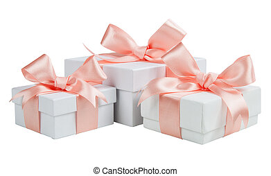 White boxes with pink ribbons isolated on white background