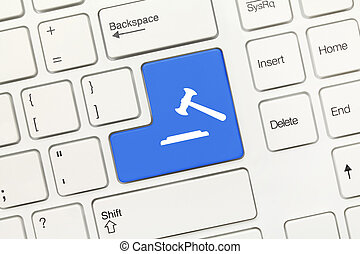 White conceptual keyboard - Blue key with gavel symbol -...