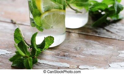 lemon and mint drink - Two glasses of homemade lemonade,...