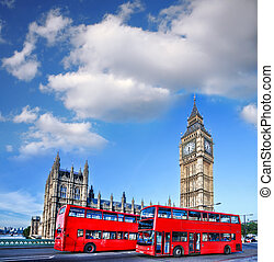 Big Ben with buses in London, England