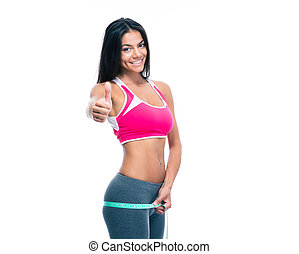 Fitness woman measure her buttocks with a measuring tape and...