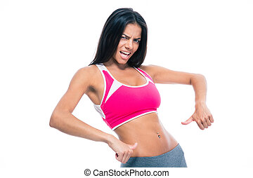 Fitness woman showing finger at her belly