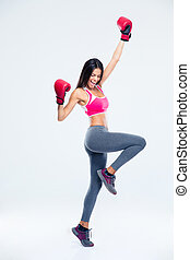Woman in boxing gloves celebrating her success - Full length...