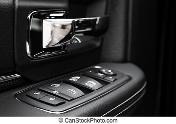 Door control panel in a modern car - Image in closeup of a...