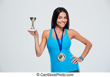 Sports woman holding winner cup