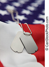 Dog tags - Vertical blank dog tags on American flag with...