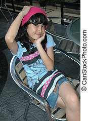 cute girl sit down in chair - cute asian girl sit down in...