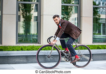 Handsome businessman and his bicycle - Handsome businessman...
