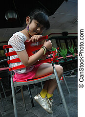 little girl sit down in chair - little asian girl sit down...