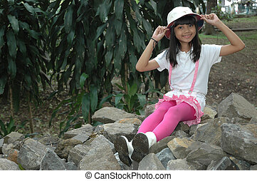 little girl sit down in park - little asian girl sit down in...
