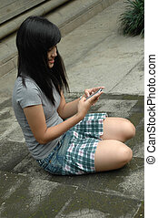 young lady sit down in park - young asian lady sit down in...
