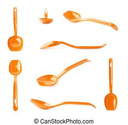 Orange plastic kitchen scoop isolated - Orange glossy...