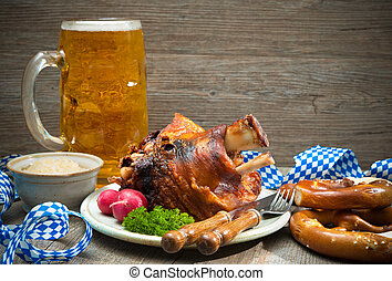 Roasted pork knuckle with pretzels and beer Oktoberfest