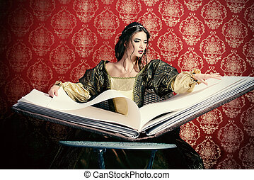 enchantress - Fairy beautiful witch reads magic book of...