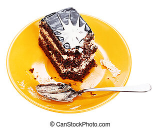 Chocolate cake on orange plate - Chocolate cake with spoon...