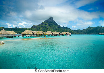 Luxury thatched roof bungalow resort on Bora Bora - Luxury...