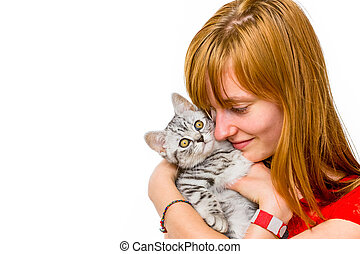 Girl hugging young silver tabby cat