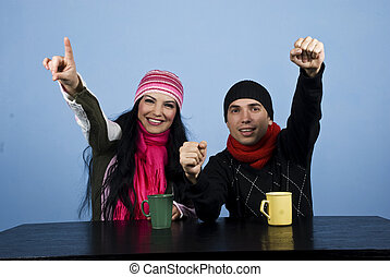 Excited couple at table in winter season - Two people couple...