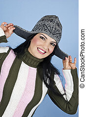 Smiling happy woman with winter cap