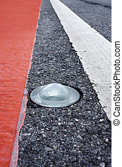 Round glass reflector on the road To prevent damage