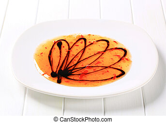Hot sauce and balsamic vinegar on plate
