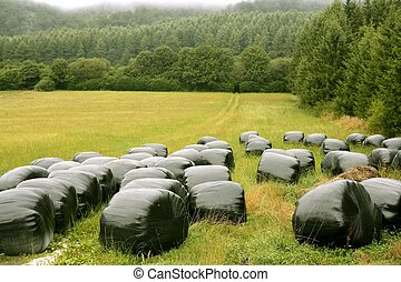 Black plastic wrap cover for cereal bales - Black plastic...