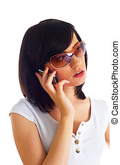 Close up of young woman talking on mobile phone