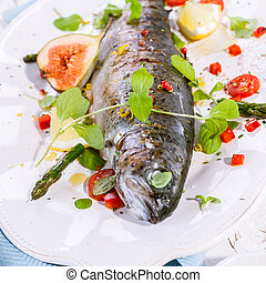 Grilled Fish on Platter with Garnish and Seasoning