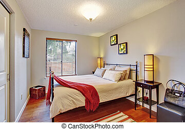 Georgous master bedroom with hardwo