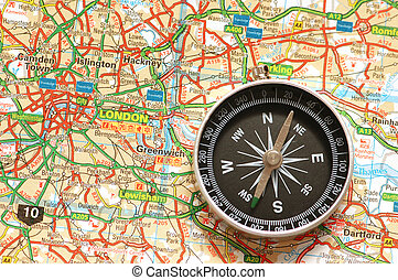 Compass over the map of UK - London suburbs
