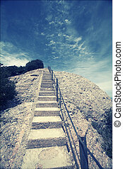 Stairway to heaven - stairway up to the peak and deep blue...