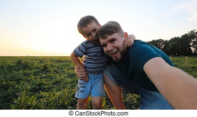 Father and son spending time together in sunny nature
