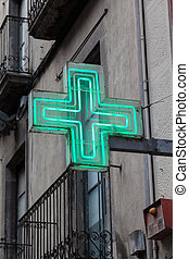 Green pharmacy sign or drug store symbol