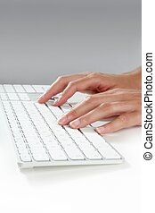 woman hands typing keyboard on desktop