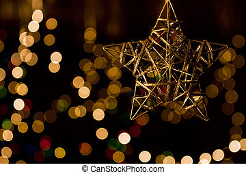 Wintery Decorations - Christmas gold star against background...