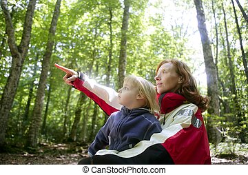Beautiful blond little daughter mum in the forest -...